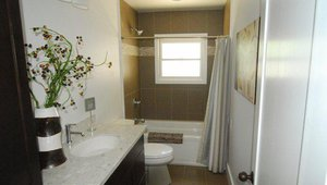 Recycled marble countertops were among the green features of the home, along with WaterSense certified fixtures.