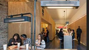 Chipotle's new store design also uses more environmentally friendly building materials and energy efficient systems, is less cluttered than the old design, and has smaller, more efficient kitchens.