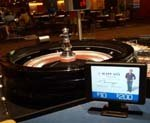 Vegas tabletop digital signs also monitor games, efficiency