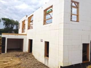 Great green home icf home by charis homes proud green home for Buildblock icf pricing