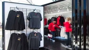One key to a successful container-based store is zealous attention to maximizing space. For Gameday Merchandising, it meant installing racks on the insides of doors and making sure as many racks as possible were presented to shoppers on the inside.