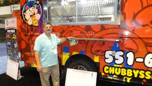 Joe Salpietra of greaselock.com visits the Custom Mobile Food Equipment booth where a custom built food truck was on display.