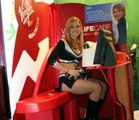 Julie, a Silver Spurs dancer, demonstrated the Virgin LifeCare kiosk, an application developed in partnership with IBM