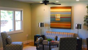 Walls were rearranged to modernize the living space, and low-VOC paints were used for indoor air quality.