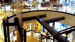 New Orleans Anthropologie features modern suspended stair installation