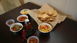 Placed at each table during the event was a sample of Qdoba menu items and ingredients. Items included Qdoba's mango salsa, chips and toasted pumpkin seeds.