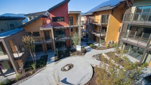 <p>The project was launched as a market catalyst for highly sustainable, climate neutral homes for the everyday person. It was a collaboration with local government, private sector companies, utilities and nonprofit. Design on the project began in 2007 and it was Built Green certified in 2011.</p>  <p>All units sold near market rate between $244K and $599K (size ranging from studio to three-bedroom).</p>
