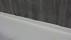 Four inches of rigid foam separate the concrete slab from the ground and the foundation walls.