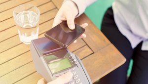 Making mobile wallets pay for consumers, small retailers