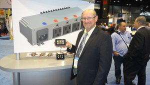 Paul Simmonds displays technology that tracks waste and ensures freshness at the Renau Corporation booth. The technology can be used on food trucks.