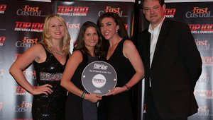 <p>Brigette Becker and Kendall Huber accept a Top 100 award for Dickey's Barbecue Pit.</p>