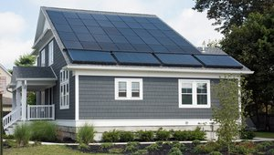 An asymmetrical roof design provides space for 8.5 kW of photovoltaic panels.