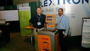 Dave Gonsiorowski (left), general manager for Flextronics, flanks the photo kiosk his company helped develop for partner Eastman Kodak, represented at right by Candido Tavarez.