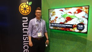 Pat Stephens presents digital signage for restaurants at the Nutrislice booth.