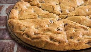 Papa John's new family-sized chocolate chip cookie is cut into eight pieces.