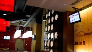 Digital signage also has a featured role in the facility's upscale bars, located just below the bowl.