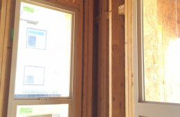 Open corners and open headers above windows are some of the advanced framing features that reduce lumber use and leave more space in the wall for insulation.