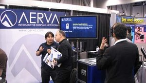 AERVA demonstrates the mobile interactivity enabled by MoApp, which allows cell phones to communicate with digital signs. The application is being used with BarCast, a digital signage network for bars and nightclubs.