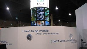 NCR's massive booth featured many financial solutions as well as walls of digital signs.