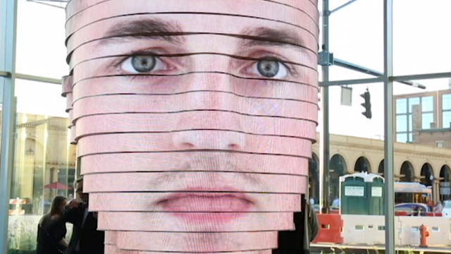 Head-shaped LED sculpture displays users' faces