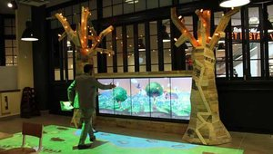 A high-tech kids area features an interactive wall, a multi-player game and gesture-based tabletop projection games.