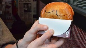 Pies are served in cardboard sleeves so customers can easily eat them in the car or while driving.