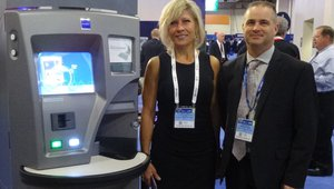 Jackie Kuehl and Robert Armatino present the QuickChange kiosks at the Glory booth.