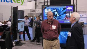 Bob Ventresca of NetKey discusses the company's digital signage software offerings with an attendee. The company recently launched a value-added reseller program.