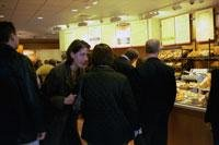 Panera franchisees take a tour of the 1,000th store.