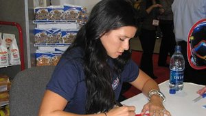 Dozens of attendees visited the Interstate Brands Corp. booth where IndyCar racer Danica Patrick signed autographs.