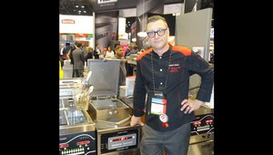Ben Leingang presents a 4-head pressure fryer at the Henny Penny Corp. booth.