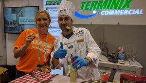 Cherryh Cansler, editor of FastCasual, samples the cricket quesadillas at the Terminex booth.