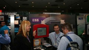 Deirdre Frank (left) and James Currey (center) talk to a visitor at the CSS (Corporate Safe Specialists) booth.