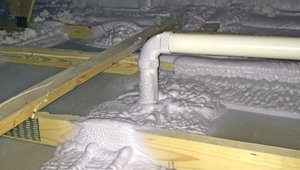 Spray foam insulation covers the top plates above interior walls to help air-seal the ceiling.