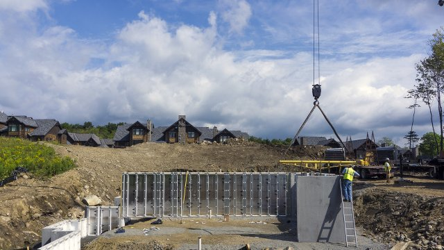 Luxury Prefab Townhouses Rise on Precast Concrete Foundations