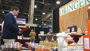 Exhibitors strolled among the color cups of treats from Oringer Foods. The company sells bases and toppings for ice cream.