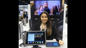 Tiffany Maldonado displays a food truck ordering kiosk at the Lavu Inc. booth.