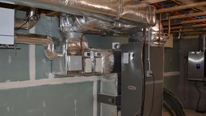 Hot water from the boiler is used to heat air that is distributed through the home using sealed ducts. The ducts are insulated to a value of R-8 and located in the conditioned space of the home to eliminate heat loss.