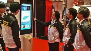 The Kingdom Majorlink Kiosk Systems Ltd. team checked out one of the company's kiosks.