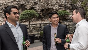 Dinesh Chauhan, franchising sales, operations manager of Sumo Sushi Bento; Jerome Mortel Sumo International mingle and Jamie Bugler of Samsung mingle at a private dinner party beside the last remaining section of London's Roman Wall. It stands undamaged from when it was originally patrolled by Roman sentries. Havi sponsored the party. Photo credit: Ryan Cansler