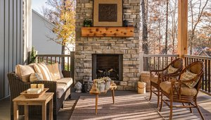 The outdoor fireplace provides the ambience of a wood fire while keeping the combustion byproducts outside of this EPA Indoor airPLUS certified home.