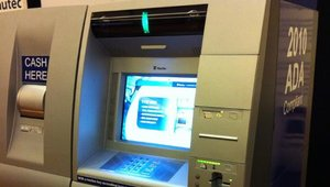 A closeup of Itautec America's Adattis intelligent-deposit ATM at the 2011 ATMIA conference in Miami. The machine is compliant with Americans with Disabilities Act requirements. Itautec is based in Doral, Fla.