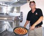 U.S. military veteran and Little Caesars franchisee Richard Cozier opened his first Little Caesars restaurant in Stafford, Va.