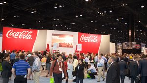 <p>The Coca-Cola booth was one of the most popular at the show. It was packed with people waiting to taste beverages from the company's Freestyle machine that allows customization.</p>