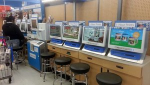 The photo center features a fleet of Fuji self-service printing kiosks.