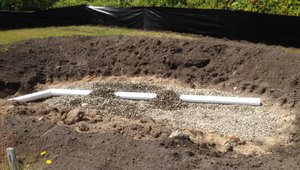 Two rain gardens were constructed on site to handle all of the roof drain off.