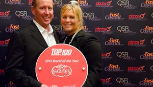 Fazoli's CEO Carl Howard and his wife, Rochinna Salvi, pose with the plaque for the brand's No. 1 placement in The 2013 Fast Casual Top 100 Movers & Shakers.