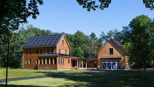 This modern farmhouse blends into the cultural landscape of Lincoln, Massachusetts - a town known for its rich history, farming traditions, conservation efforts, and visionary architecture.  The home is proof that families do not need to compromise on style, space or comfort in a highly energy-efficient and healthy home.  The all-electric home consumes 70 percent less energy than a code-built house, and with measured energy data produces 48 percent more energy annually than it consumes, making it a 'net positive' home.  Thick walls and roofs lack thermal bridging, by using dense-packed cellulose and continuous rigid insulation. High performance, triple-glazed windows round out the super-insulated building envelope. The continuous air barrier yields minimal leakage, with testing revealing only .27ACH50, making the home among the tightest in the US.