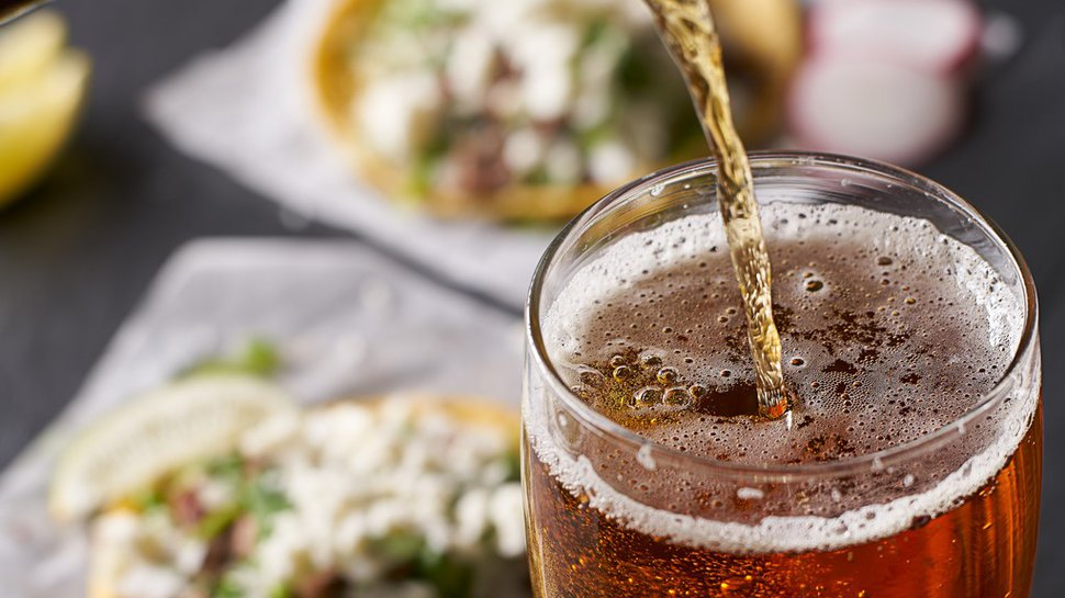 350 boozy Taco Bells by year-end? Not quite