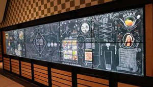 A 23-foot video mural greets daily commuters as they pass the restaurant.